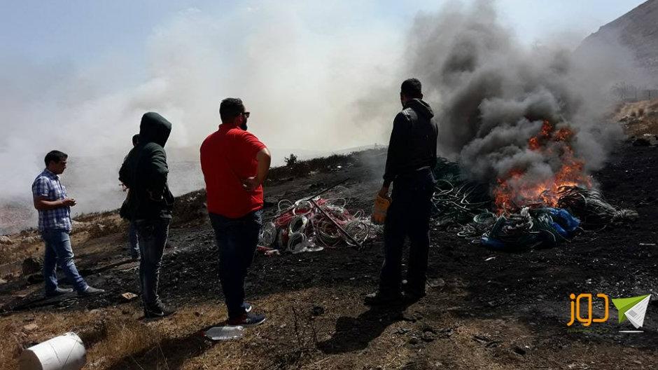 حرق كوابل مستعملة وتلوث بيئي في نابلس